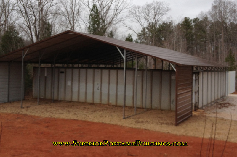 A frame carport for sale with lean tos on each side
