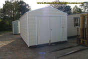10 x 20 ga portable building cream and white double door.