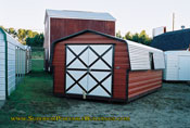 10 x 20 barn red with black trim double doors.