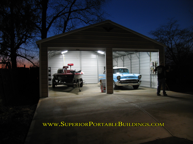 24 x 30 x 9 steel garage with the lights on